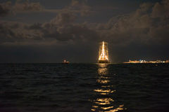 Ship glowing in the sea Stock Images
