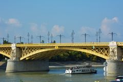 Ship going through Danube river, Margit hid, Margit bridge in Budapest Royalty Free Stock Image