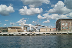 Ship granary and cranes in port. Stock Photos