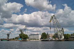 Ship granary and cranes in port. Royalty Free Stock Photography