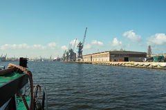 Ship granary ma cranes in port. Royalty Free Stock Photography