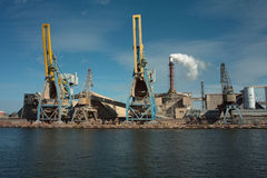 Ship granary ma cranes in port. Stock Photos