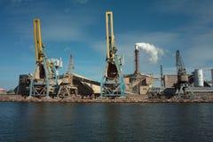 Ship granary ma cranes in port. Stock Photos