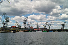 Ship granary ma cranes in port. Royalty Free Stock Image
