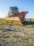 The ship graveyard of the Aral Sea. The Aral Sea is a formerly undrained salt lake in Central Asia, located on the border of Kazakhstan and Uzbekistan. Since Stock Image