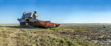 The ship graveyard of the Aral Sea. The Aral Sea is a formerly undrained salt lake in Central Asia, located on the border of Kazakhstan and Uzbekistan. Since Royalty Free Stock Photography