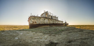 The ship graveyard of the Aral Sea. The Aral Sea is a formerly undrained salt lake in Central Asia, located on the border of Kazakhstan and Uzbekistan. Since Stock Photos