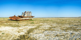 The ship graveyard of the Aral Sea. The Aral Sea is a formerly undrained salt lake in Central Asia, located on the border of Kazakhstan and Uzbekistan. Since Royalty Free Stock Photos