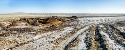 The ship graveyard of the Aral Sea. The Aral Sea is a formerly undrained salt lake in Central Asia, located on the border of Kazakhstan and Uzbekistan. Since Royalty Free Stock Images