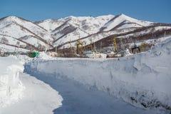 Ship graveyard and snowy mountains. Petropavlovsk-Kamchatsky, Ka Stock Photography