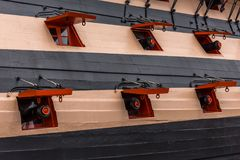 Ship Gun Ports. The gun ports and cannons on the side of HMS Victory royalty free stock photos