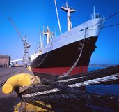 Ship in harbor. Being offloaded quayside Royalty Free Stock Images