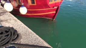 Ship in harbor with  buoys, rope and green water. Ship in the harbor with windows, buoys, rope and green water stock video footage