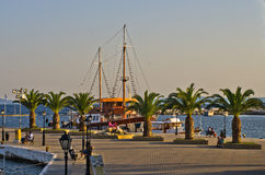 Ship in harbor of Neos Marmaros at golden hour, Sithonia Royalty Free Stock Image