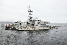 A ship has run aground in shallow waters. And is sinking stock photo