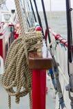 Ship hawser. On pretty decorated standard ships rail Stock Photo
