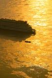 Ship Heading Towards Sunset Stock Images