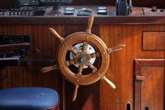 A ship helm. The Classic Steering Wheel of a Tall Sailing Ship stock photography