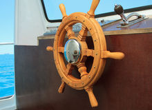 Ship helm in the wheelhouse Stock Photo