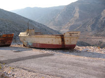 Ship on hills. Old damaged ship 'Manolis stock images