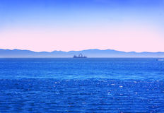 Ship the horizon Stock Image