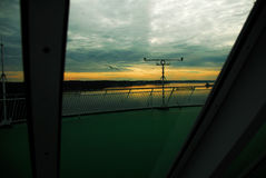 Ship horizon. Cloudy sunset behind a windscreen on a sailing ferry Stock Photos
