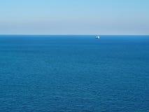 Ship on the horizon Royalty Free Stock Photo