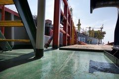 Ship hose handling operation royalty free stock image