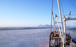 Ship in the ice. The ship floats in the ice of the bay Sheltinga Stock Photography