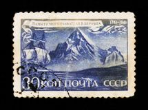 Ship and iceberg, in memory of V. Bering, famous Danish polar sea explorer in Russian service, circa 1941. MOSCOW, RUSSIA - JUNE 26, 2017: Rare stamp printed in Stock Photo