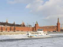 The ship - the icebreaker ice pricks. Moscow - January 7, 2016: The ship - the icebreaker splits the ice on the river Moscow, at the walls of Moscow Kremlin in Stock Images
