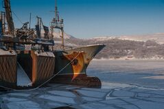 Ship in icy harbor Royalty Free Stock Photos