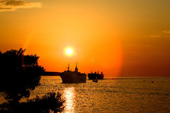 Ship In Sunset Stock Images