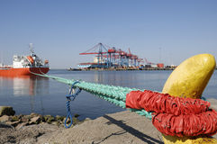 Ship infront of container-port Stock Photo