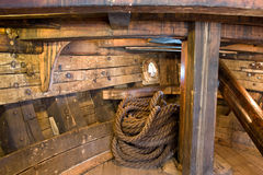 Ship interior with rope. Ship interior with a coil of rope stock images