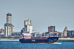 Ship on its way to Antwerp at Vlissingen waterfront royalty free stock images