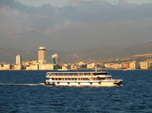 Ship on Izmir downtown background. View on Izmir downtown from Izmir's bay Royalty Free Stock Image