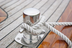 Ship Knotted Onto Pier With White Rope. Secured & Safe Sailing Ship. Safety Concept Royalty Free Stock Photos
