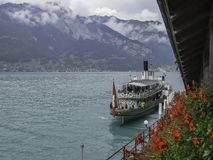 Ship on Lake Brienz and the swiss alps near interlaken royalty free stock image