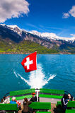Ship in Lake Brienz with swiss flag and Brienzer Rothorn view. royalty free stock photo