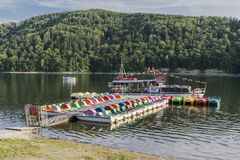 Ship on the lake. Small touristic ship name Rak moor to the platform on the Lake in Roznow , Poland. Europe. Evening time Stock Image