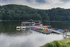 Ship on the lake. Small touristic ship name Rak moor to the platform on the Lake in Roznow , Poland. Europe. Evening time Royalty Free Stock Images