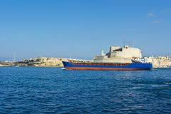 Ship leaves the harbor. Cargo ship leaves the harbor of Valletta Stock Photos