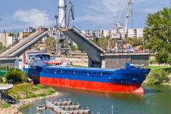 Ship leaving through bascule bridge Royalty Free Stock Photography