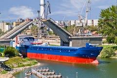 Ship leaving through bascule bridge Royalty Free Stock Photography