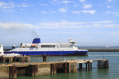 Ship leaving Dover harbor in England Stock Image