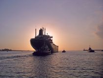 Ship leaving port for dusk or dawn Stock Image