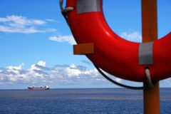 Ship and lifesaver. View of cruise ship from cruise ship balcony and lifesaver Royalty Free Stock Image