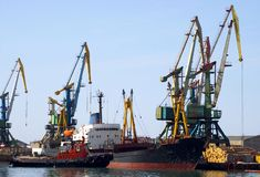 Ship and lifting tap in seaports Stock Photos