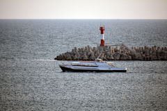 A ship and the lighthouse Royalty Free Stock Image